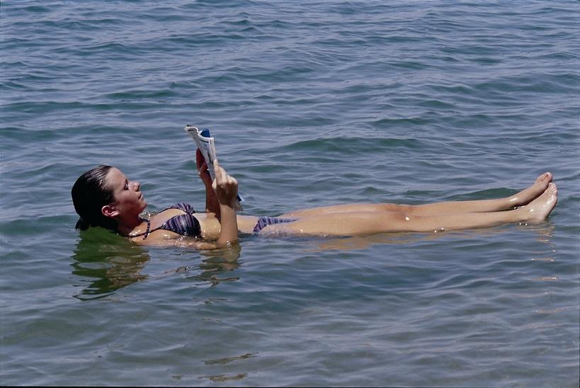 Woman floating on Dead Sea, Jordan